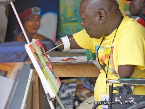 PHOTO: Haiti Art - WOW... A Handicapped Painter Painting in CARIFESTA XII, No Hands!