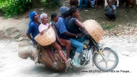 Look... A Haitian Taxi Moto carrying 4 passengers plus the driver