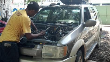 PHOTO: Car trouble, Mechanic working on it