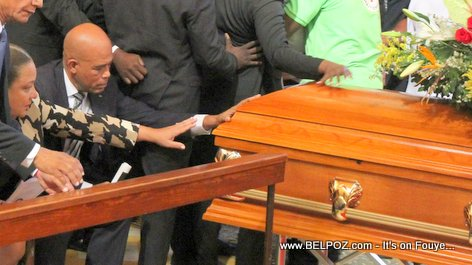 PHOTO: Haiti Funeral - President Michel Martelly first lady Sophia touching the casket of rapper BLACK ALEX