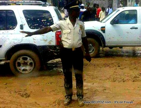 PHOTO: Haiti after the rain - Carrefour Traffic Police Covered in Mud