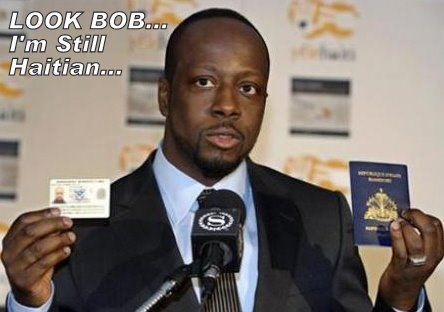 Wyclef Jean Holding His Green Card And Haitian Passport