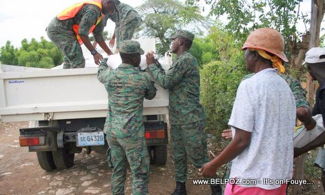 Haitian Soldiers distributing food in Northern Haiti after Hurricane Irma