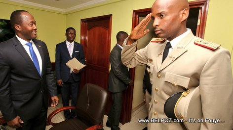PHOTO: Haiti - A Haitian Military man Salutes as Information DG watches proudly