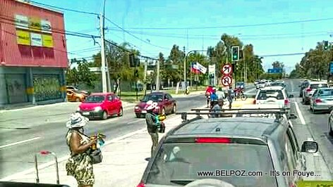 PHOTO: Haitians selling soft drinks on the side of the road in Chile