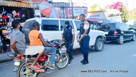 Most Haitian bike riders do not wear a Motorcycle Helmets
