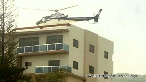 Haiti - Helicopter evacuated unidentified individuals on Peguyville rooftop Sunday after gas riots