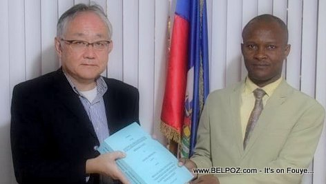 Makihara Takatomo of Tokura Corporation, Japan, and Meniol Jeune, director general of education in Haiti