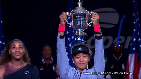 PHOTO: Naomi Osaka raises her 2018 US Open Grand Slam Title Trophy