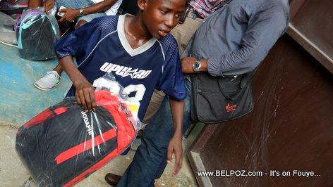 PHOTO: This Haitian student got a free school bag courtesy of Senator Rony Celestin
