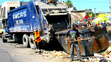 PHOTO: Haiti Waste Management - SMCRS garbage truck picking up the trash