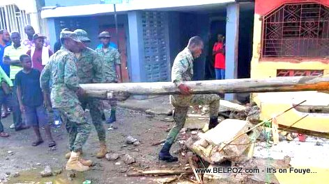 PHOTO: Haitian Army soldiers clearing the streets of Port-de-Paix after the earthquake
