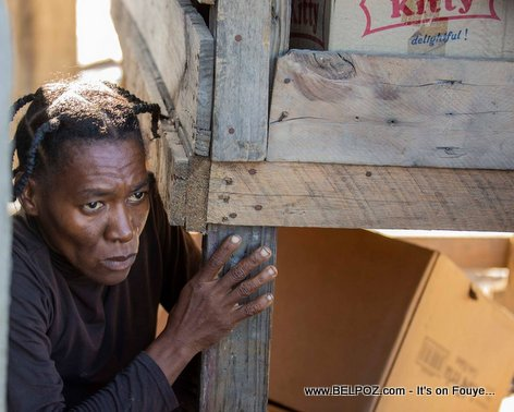 Look at the FEAR in the eyes of this Haitian woman during a Street Protest in Haiti