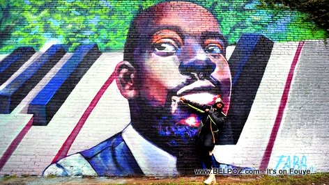 Mural of Wyclef Jean unveiled in Newark, New Jersey. That's Wyclef standing in front of it