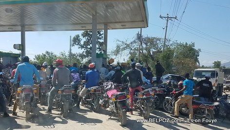 Gas shortage in Haiti - Motorcycles line up for some Gasoline