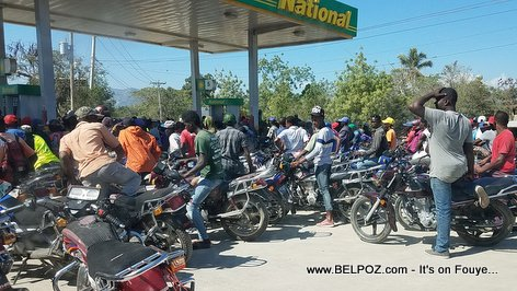 So many motorcycles at a gas station in Haiti during a gas shortage