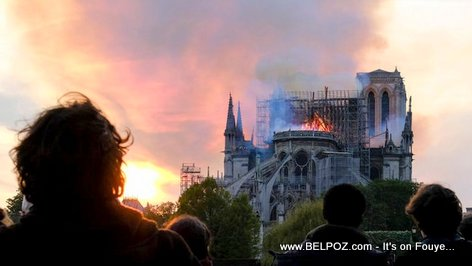 People stand in shock as the Notre Dame Cathedral in Paris France burns down