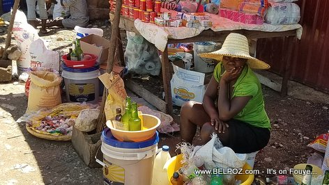 PHOTO: Ti Machan in Haiti with her hands on her face, life is hard