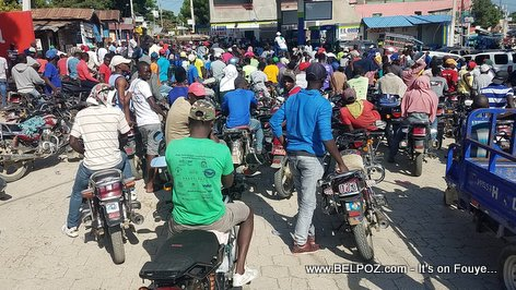 PHOTO: Motorcycles Line up at a Haiti Gas Station waiting for some Gasoline