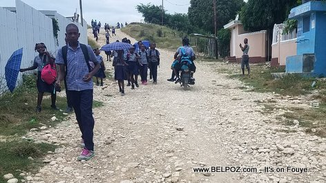 Students in Haiti coming from school