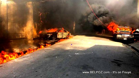Haiti - Cars parked in the vicinity of Radio and Television Caraibes on Fire