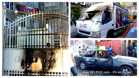 PHOTO: Radio Caraibes FM front gate burned down, vehicles burned by protesters