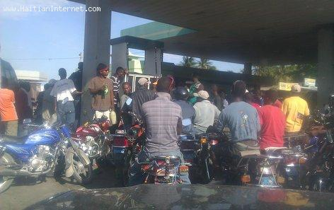 Gas Shortage in Haiti - Motorcycles Storm a Pump with a Little Gas