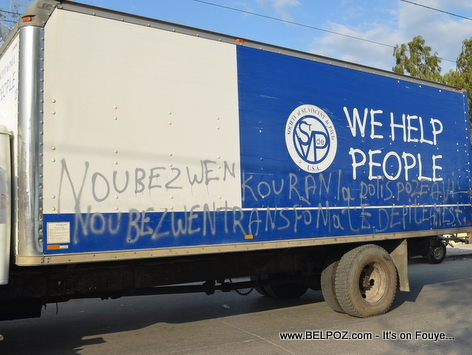 Coincidences - A Truck labeled 'We Help People' has Haitian Creole demands all over it