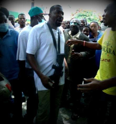 Haiti Depute Arnel Belizaire with Assault Rifle at a Protest 10 June 2014