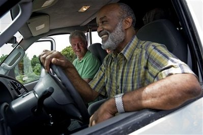 President Bill Clinton and President Rene Preval on a Road Trip, Preval is driving