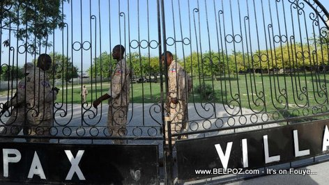 PHOTO: Haitian Police watching the gates of Pax Villa where Jean Claude Duvalier is kept