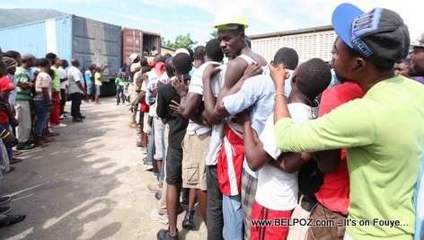 PHOTO: Haiti - Flooding in Cap Haitien - Flood victims in line for government assistance...